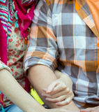 Girl and man holding hands Stock Photos