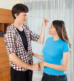 Girl and man measuring each other Royalty Free Stock Photos