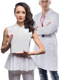 The girl and the man in medical clothes Royalty Free Stock Photos