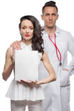 Girl and man in medical clothes with white sign Royalty Free Stock Photos