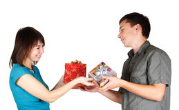 Girl and man present gifts to each other Stock Photography