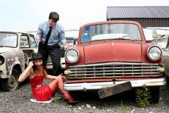 Girl and man beside retro car stock images