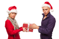 Girl and man with santa hat fighting for a present Stock Photo