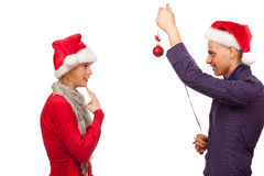 Girl and man with santa hat fighting for a present Stock Photos