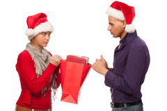 Girl and man with santa hat fighting for a present Stock Photography