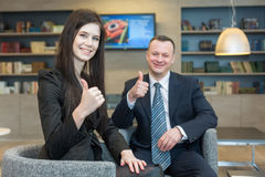 A girl with a man showing thumbs up Royalty Free Stock Photos