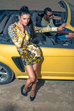 Girl man and sport yellow car Stock Image
