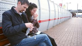 Girl and man are waiting for train stock video footage