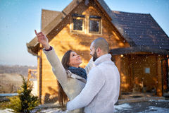 Girl and man on winter holiday on mountain Royalty Free Stock Images