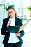 The girl with the manager open the folder in his hands what is thought Royalty Free Stock Images