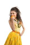 Girl with mandarin Stock Photos