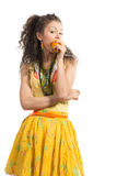 Girl with mandarin Stock Images