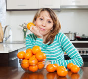 Girl with mandarines Stock Photography