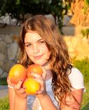 Girl with mango Stock Image
