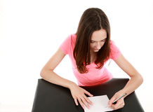 Girl with manicured hands writing Stock Image