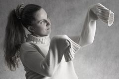 Girl in mantis position. Girl in wool sweater. mantis position Stock Image