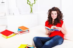 Girl with many books Royalty Free Stock Photo