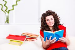 Girl with many books Stock Image