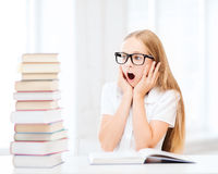 Girl with many books at school Royalty Free Stock Photo