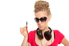 Girl many plaits hairstyle with headphones Royalty Free Stock Images