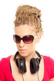 Girl many plaits hairstyle with headphones Stock Image
