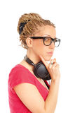 Girl many plaits hairstyle with headphones Stock Photo