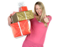 Girl with many present boxes shows thumb up Royalty Free Stock Photo