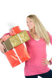Girl with many present boxes shows thumb up Royalty Free Stock Images