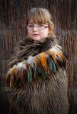 Girl in Maori cloak. Young girl wearing a traditional Maori clock from New Zealand stock photo