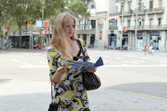 Girl with a map. In Spain Stock Photography