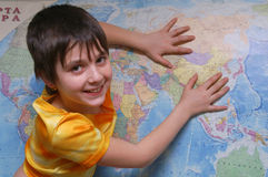 The girl and the map. Of world Royalty Free Stock Images
