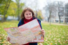 Girl with a map Stock Image