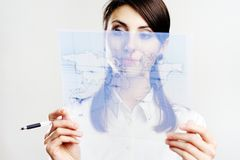 Girl with map of the world Royalty Free Stock Image