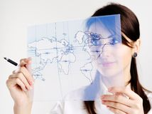 Girl with map of the world. The girl with the map of the world printed on a transparent material Royalty Free Stock Photo