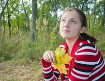Girl  with  maple-leaf Royalty Free Stock Photos