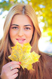 Girl with maple leaf Stock Photo
