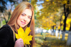 Girl with maple leaf Royalty Free Stock Images