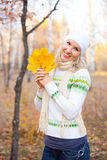Girl with maple leaves Royalty Free Stock Photography