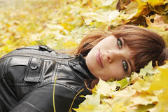 Girl on maple leaves Royalty Free Stock Photography
