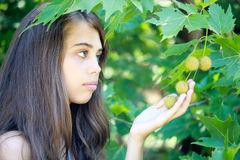 Girl and maple leaves Stock Photos