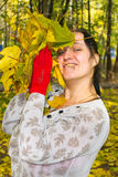 Girl with maple leaves. Girl holding a bunch of fallen autumn leaves Stock Image