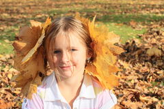 Girl with maple leaves Stock Photo