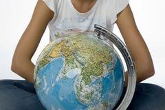 Girl with Mappamondo Royalty Free Stock Photography