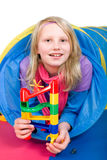 Girl with Marble Run. Little girl playing with a Marble Run Royalty Free Stock Photo