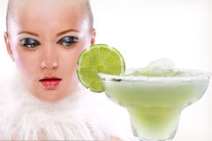 Girl and Margaritas with lime Stock Photography