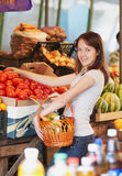 The girl is in the market. The smiling girl is in the market Stock Photos