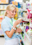 Girl at the market purchasing cosmetics Royalty Free Stock Image