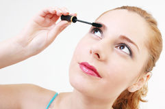 Girl with mascara Royalty Free Stock Image