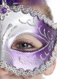 Girl in Mask. A girl in a halloween or mardi gras mask on a white background