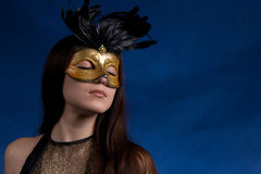 The girl in a mask Royalty Free Stock Image